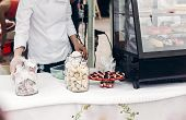 Colorful Desserts Meringue And Whipped Cream Cookies On Table At Street Food Festival. Candy Bar Wit poster