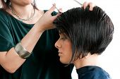 stock photo of hair cutting  - Young beautiful woman at the hairdresser salon - JPG