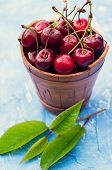 Fresh Cherry In A Ceramic Bucket On A Blue Background. Fresh Ripe Cherry. Cherries. poster