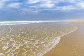 Ocean Beach On The Atlantic Coast Of France Near Lacanau-ocean, Bordeaux, France. Windy And Cloudy S poster