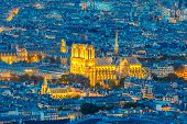 Night View Of Notre Dame De Paris From The Panoramic Terrace Of Tour Montparnasse. Closeup Of Notre  poster