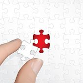 Vector Hand Holding Puzzle Piece