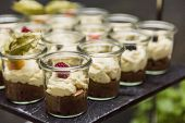 Wedding Buffet With Sweet Chocolate, Cream Souffle And Raspberries On Banquet. Candy Bar In Luxury R poster