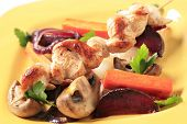 Chicken skewer decorated with lovage and button mushrooms