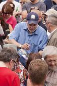 RIDGEFIELD PK, NJ-JULY 14: Famous 77 WABC radio host and dog lover Mark Levin signs his autograph for a fan in the crowd at the 2nd Annual Bark In The Park on July 14, 2012 in Ridgefield Park, NJ.