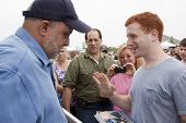 RIDGEFIELD PK, NJ-JULY 14: Famous 77 WABC radio host and dog lover Mark Levin speaks to a fan seeking his autograph at the 2nd Annual Bark In The Park on July 14, 2012 in Ridgefield Park, NJ.
