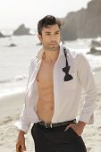 Great looking fit man in open white shirt formal wear outdoors with sexy body