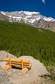 Picnic bench with gorgeous view at snow mountain in Canada.