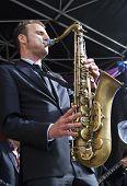Jeroen Van Genuchten Dressed In A Suit Plays Tenor Sax