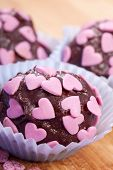 chocolate pralines with pink hearts