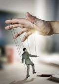 stock photo of obey  - Businessman On Strings - JPG