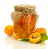 canned apricots in a jar and sweet apricots isolated on white