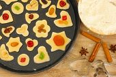 unbaked cookies with candied fruits and nuts in a pan close-up