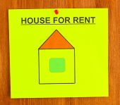 poster about renting the house on wooden background