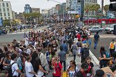 SAN DIEGO, CALIFORNIA - JULY 13: Crowds of participants cross the street in the gaslamp district while at Comicon in the Convention Center on July 13, 2012 in San Diego, California.