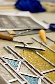 stock photo of stained glass  - Renovation of old stained glass as manual work - JPG