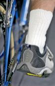 Cycle Details And Man's Foot On Pedal In Lower Position