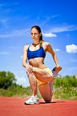 Young sporty woman Stretching Quadriceps