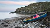 Blue Boat On Shore At Lulworth Cove