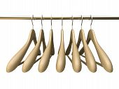 Seven Wood Hangers Isolated On The White Background