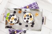 Two Yoghurt Desserts With Blueberries From Top