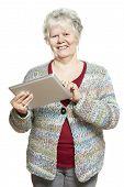 Senior Woman Using Tablet Computer Smiling