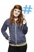 Teenage Girl Holding A Social Media Sign Smiling