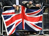 LONDON - UK, APRIL 17: Man holding a portrait of Baroness Thatcher  along the Procession route, on A