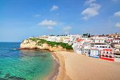 Portuguese Villa In Carvoeiro Beach With Clear Blue Sea. In The Summer The Top View.
