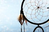 picture of dreamcatcher  - Beautiful dream catcher on blue background with lights - JPG