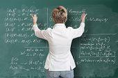 Teacher showing figures on the blackboard