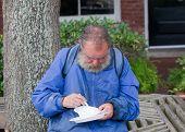 Homeless Man Eating