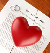 red heart with torn Divorce decree document, on wooden background close-up