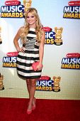 LOS ANGELES - APR 27:  Olivia Holt arrives at the Radio Disney Music Awards 2013 at the Nokia Theater on April 27, 2013 in Los Angeles, CA
