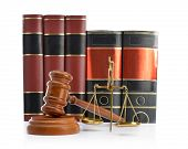Scales of justice, law books and gavel isolated on white background
