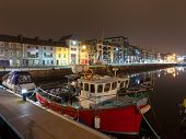 picture of galway  - Night view on row of buildings and fishing boats in Galway Docks - JPG