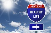 Red and blue interstate road sign Next Exit Healthy life