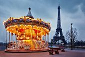 stock photo of merry-go-round  - illuminated vintage carousel close to Eiffel Tower - JPG