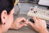 foto of prosthesis  - Technician in a dental laboratory manufacturing a prosthesis - JPG