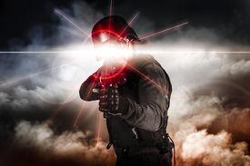 pic of gunshot  - Soldier aiming assault rifle laser sight - JPG