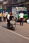 Vespa Rider With Child On Early Morning