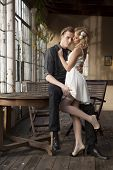 Portrait of young adult couple in love posing in classic elegance clothes to date