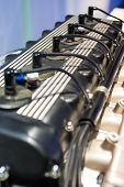 Six Cylinder Car's Engine Closeup. Over Blurred Background