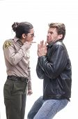 stock photo of breaker  - Frightened Caucasian law breaker begs for mercy and receives warning from young bold female sheriff deputy on white background - JPG