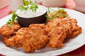 Latkes, hebrew potato pancakes served with sour cream