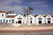 picture of larnaca  - A row of old buildings and a modern statue in Larnaca Cyprus - JPG