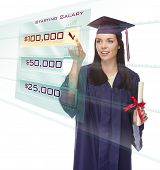 Attractive Young Mixed Race Female Graduate in Cap and Gown Choosing $100,000 Starting Salary Button on Futuristic Translucent Panel.