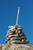 Stone Cairn As A Navigation Mark On The Top Of Mountain