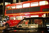 Red Vintage Bus And Classic Style Taxi In London.