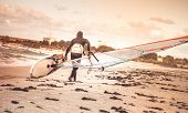 Windsurfer With Board On Beach Seaside Back View Sea Windsurfing Sport Lifestyle Concept
